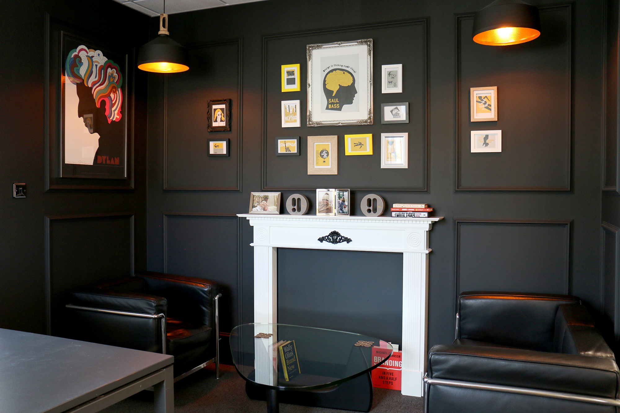 Dark grey painted executive office with fire place surround