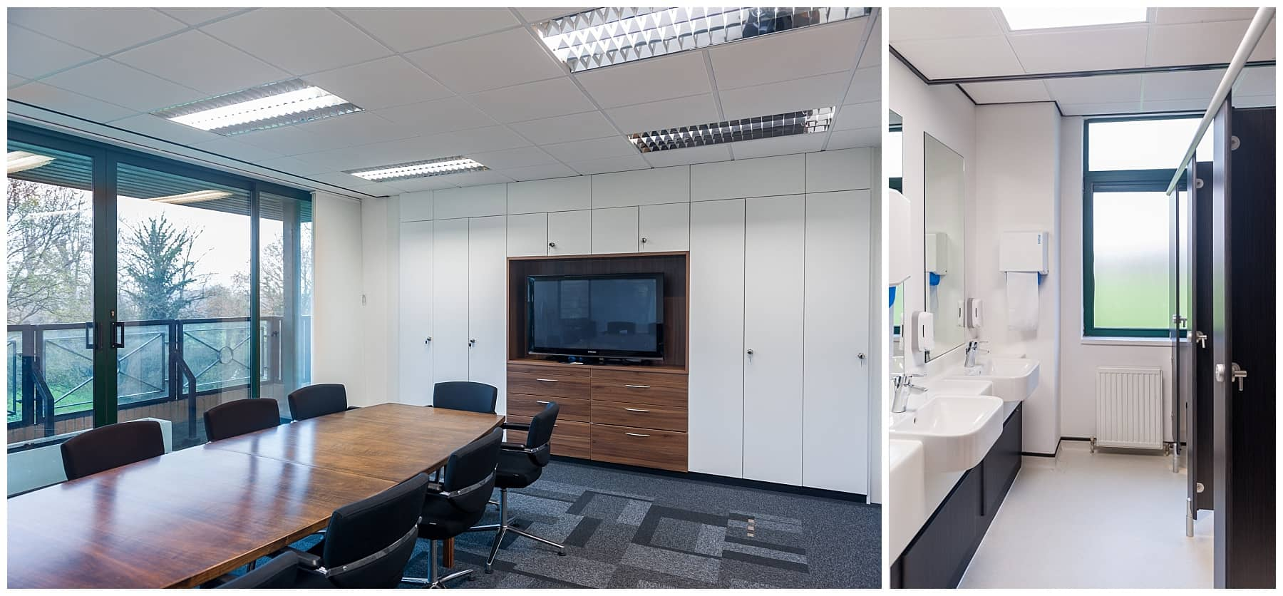 wooden boardroom table with black chairs and TV mounted in storage wall
