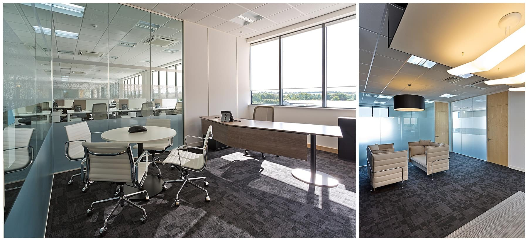 Executive office with white round table and chairs and corner desk