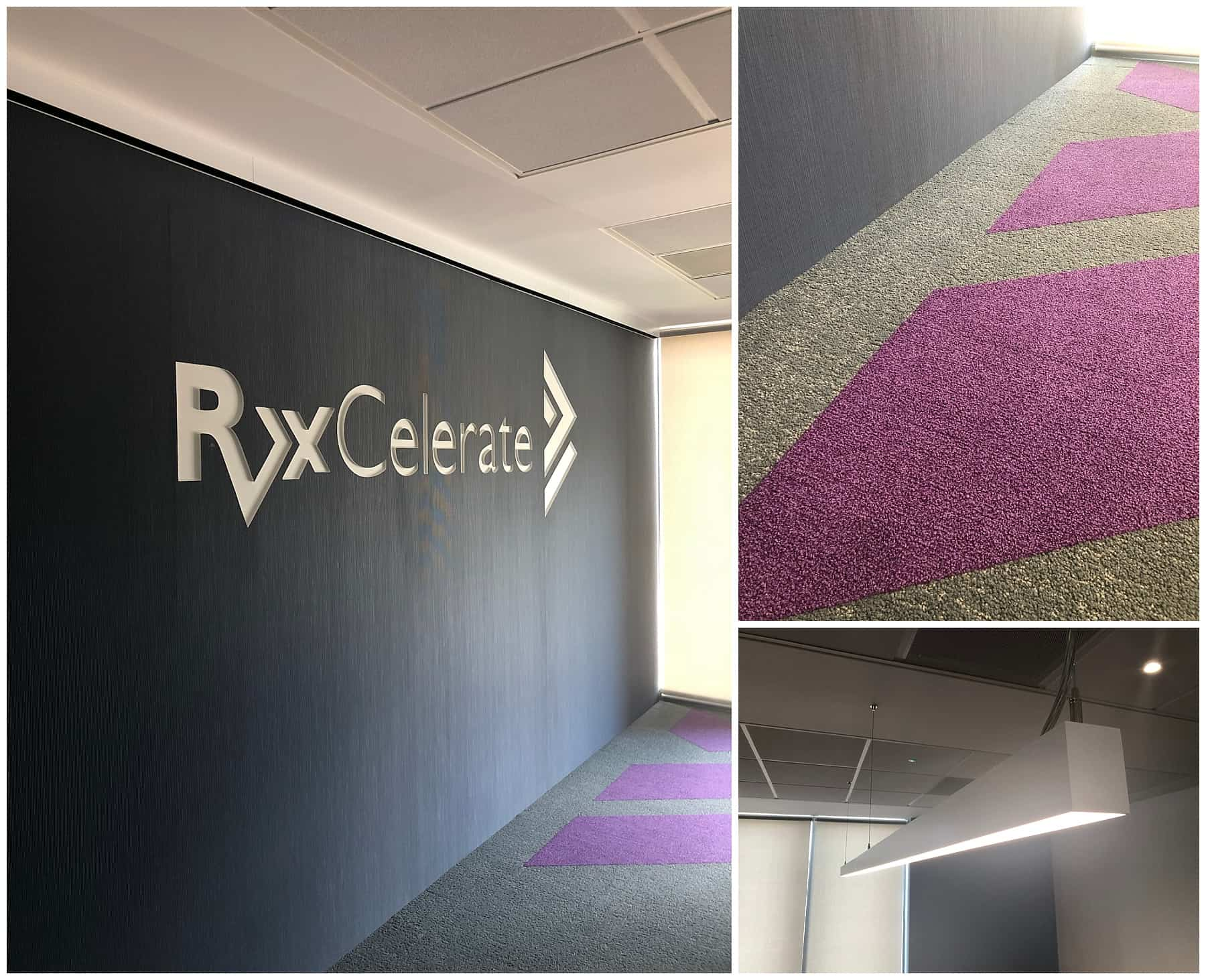 black wall with RxCelerate logo on it and purple patterned carpet and long white light fitting
