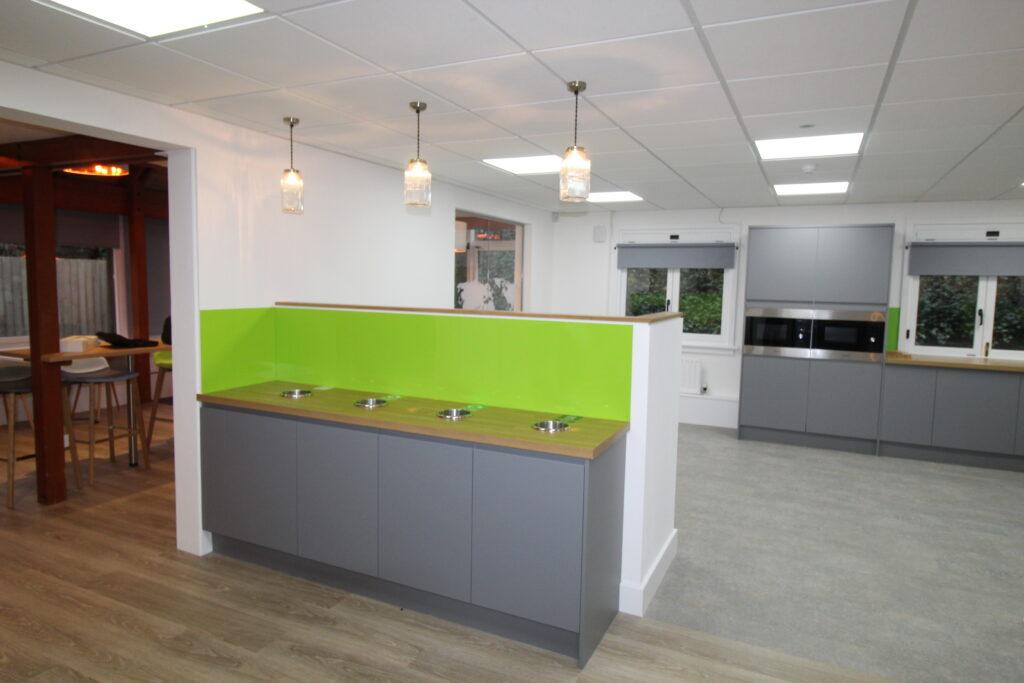 grey kitchen units with lime green splashback