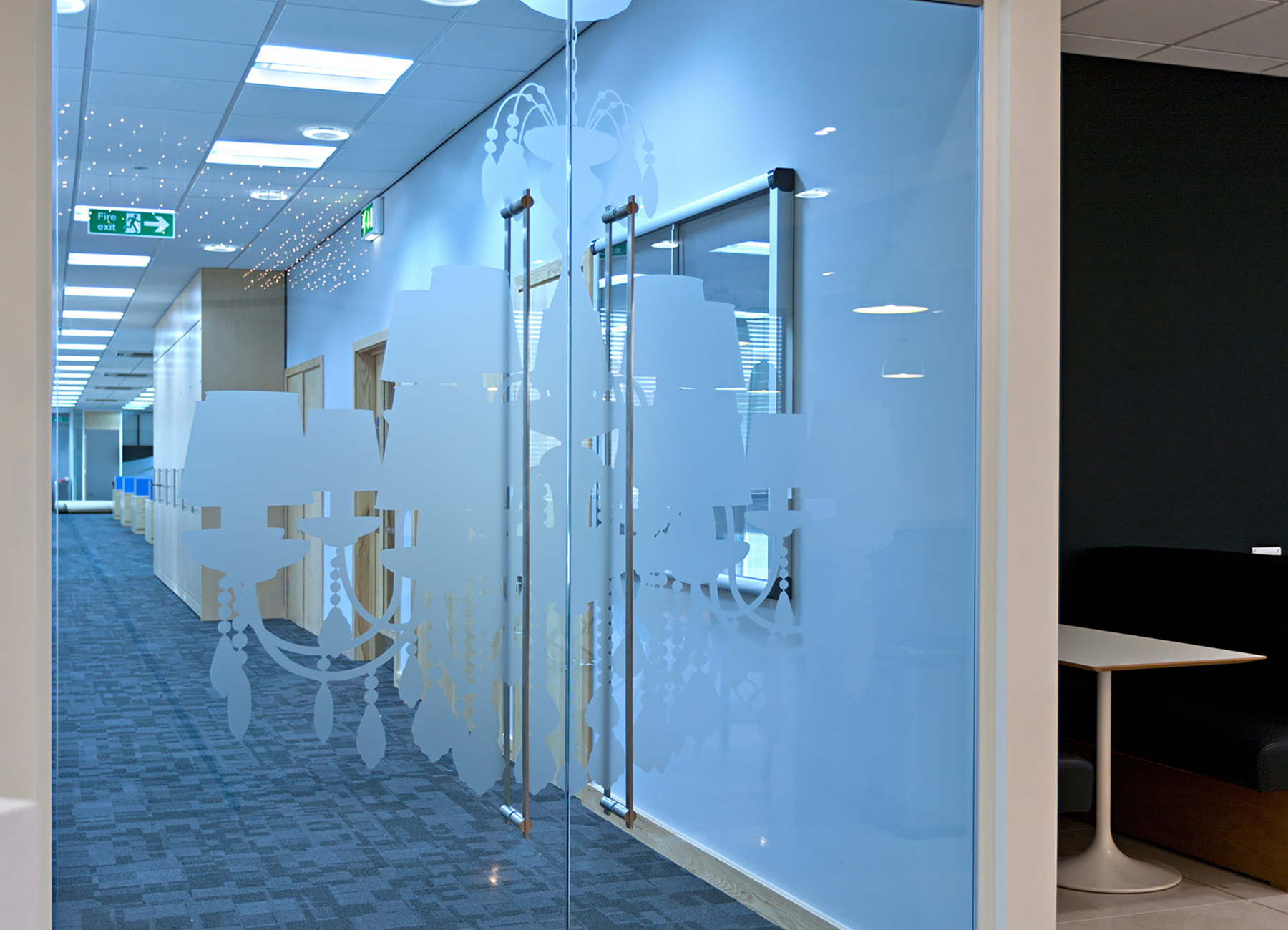 Glazed partition doors with manifestation on them