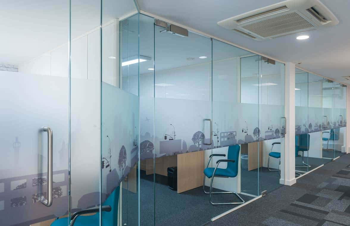 full height glass paritions with opaque patterned manifestation