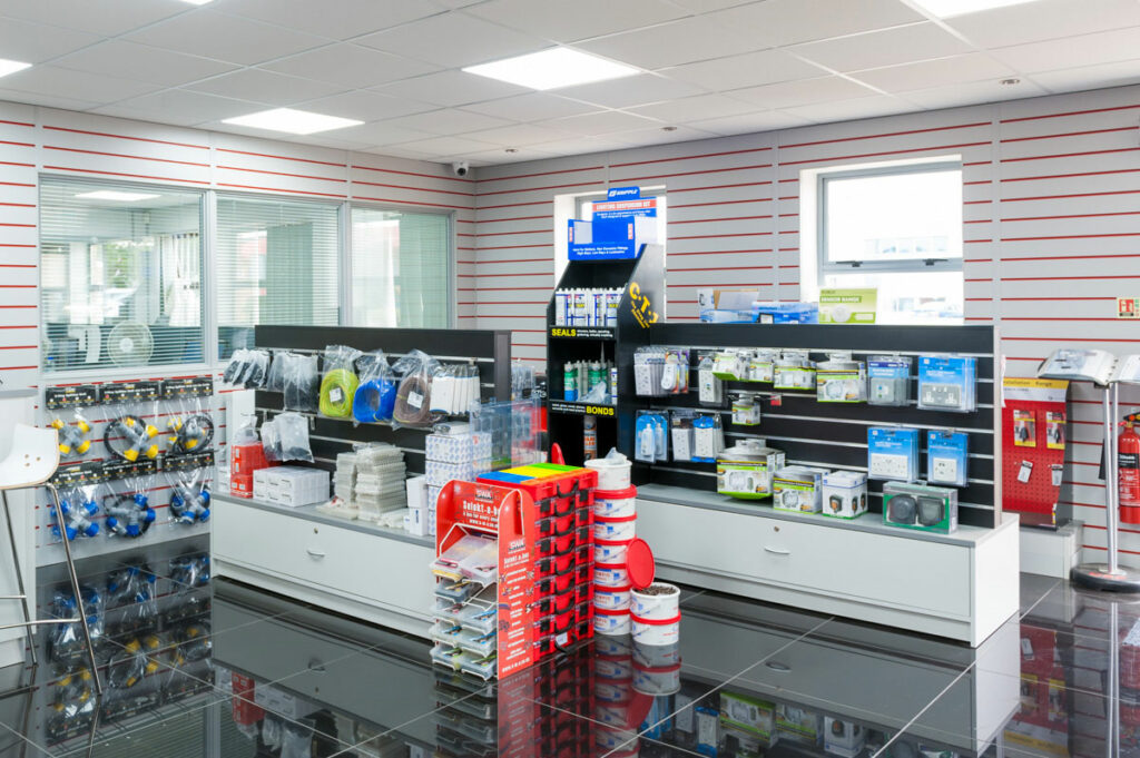 Inside an electrical shop retail space. Showing shelves with products on.