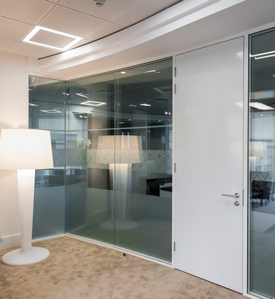 glass paritioning, tall white door and standing white lamp