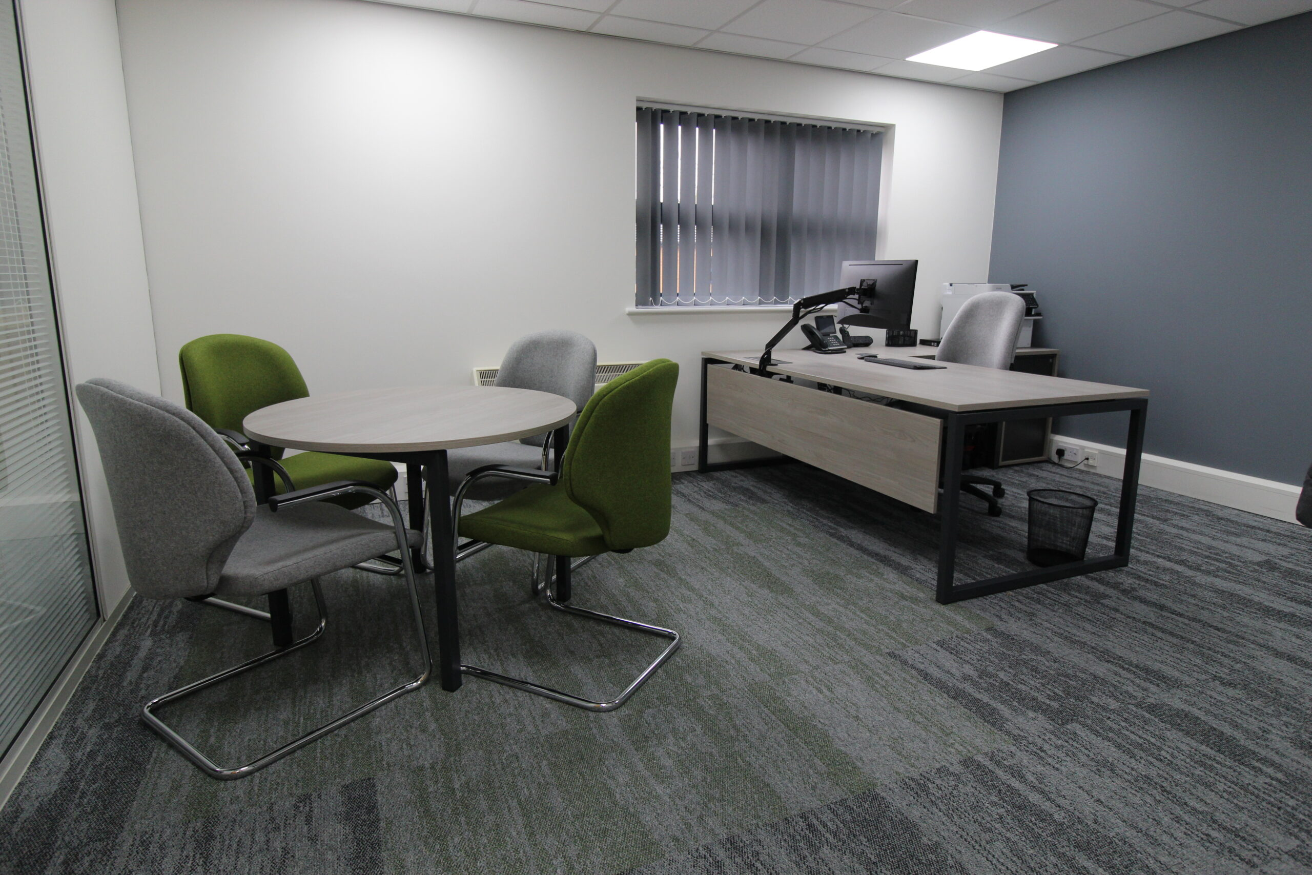 office with desk table and chairs